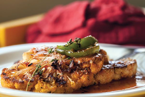Cauliflower Steak with Miso-Rooster Sauce from The Lusty Vegan by Ayinde Howell and Zoe Eisenberg