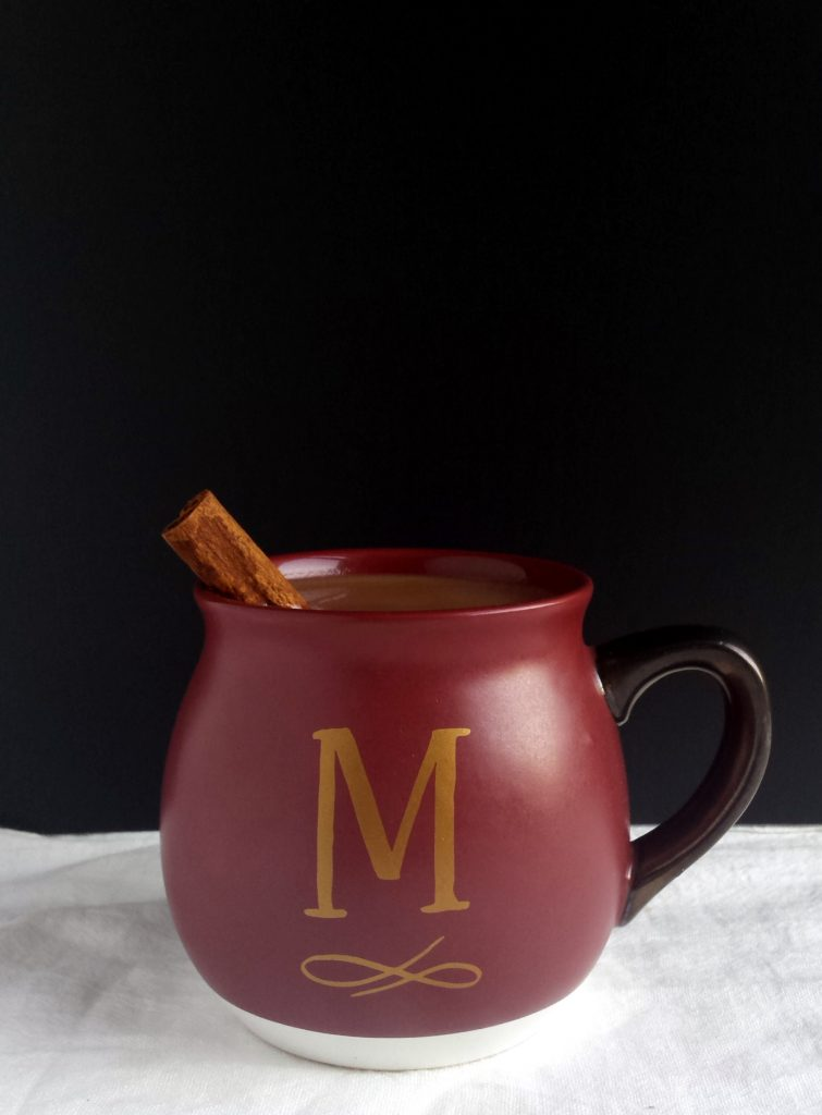 Treat yourself to a mug of Hot Spiced Coconut Apple Cider on a chilly fall evening. #applecider #vegan