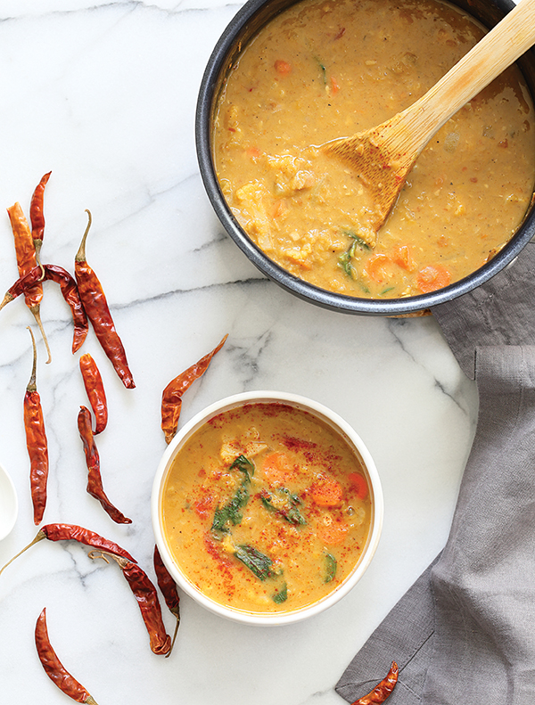 Serve this very slurp-able Red Curry Soup from Vegan Richa with large soup spoons. It's vegan and gluten-free #vegansoup #vegan #glutenfree #vegancurry #chicvegan