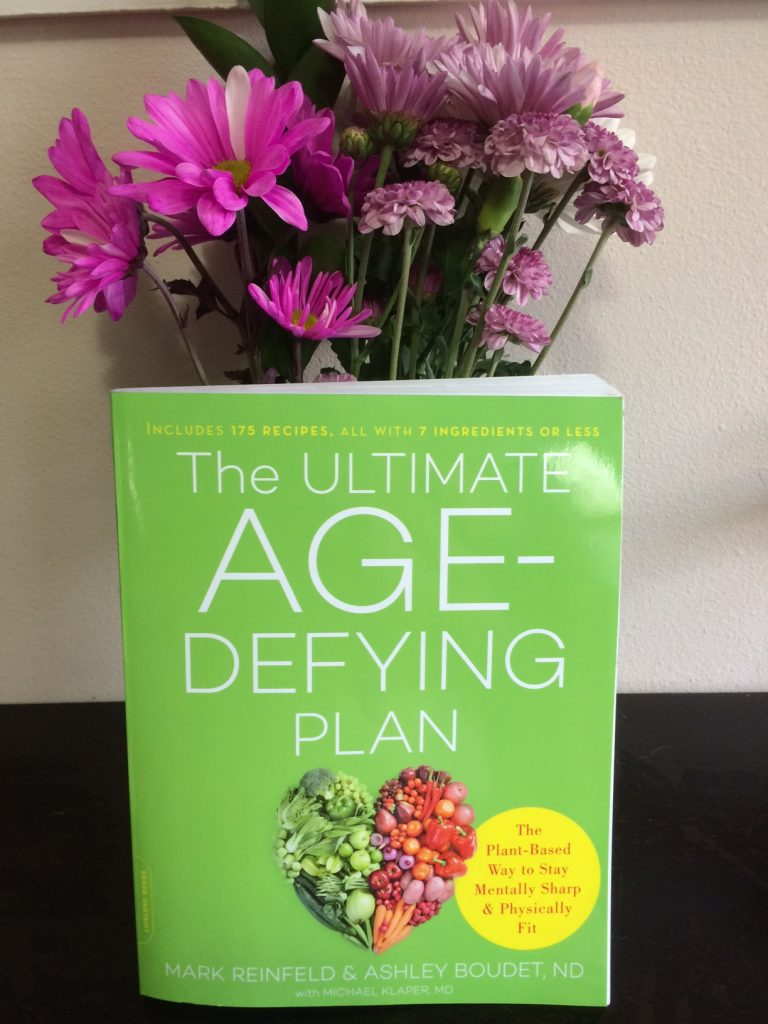 Ultimate Age Defying Plan book with flowers