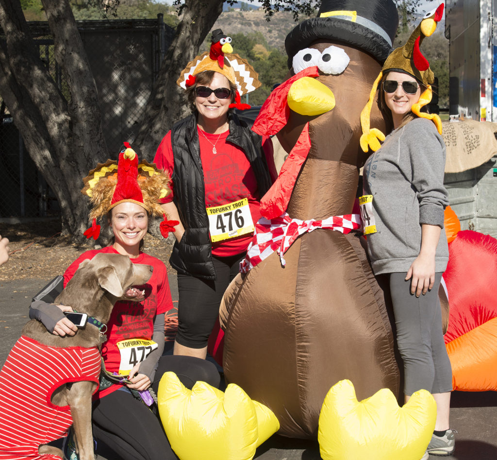 Racers embrace a giant turkey at a Tofurky Trot